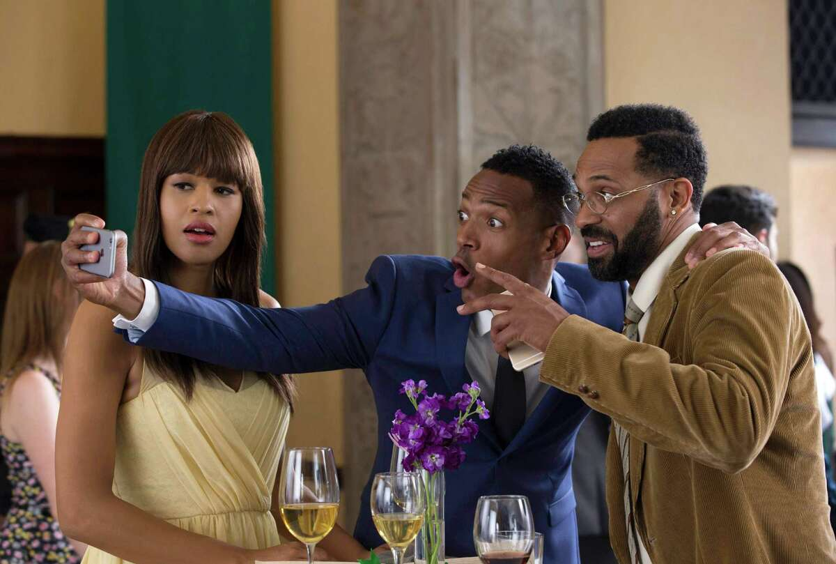 """In this image released by Open Road Films, Kali Hawk, from left, Marlon Wayans and Mike Epps appear in a scene from """"Fifty Shades of Black."""" Keep clicking for a look at the best and worst movies of the year so far."""