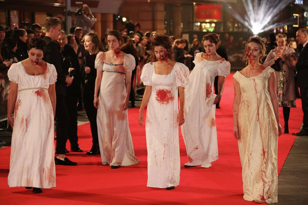 """Actors dressed as zombies arrive at the premiere of the film """"Pride and Prejudice and Zombies"""" in London."""