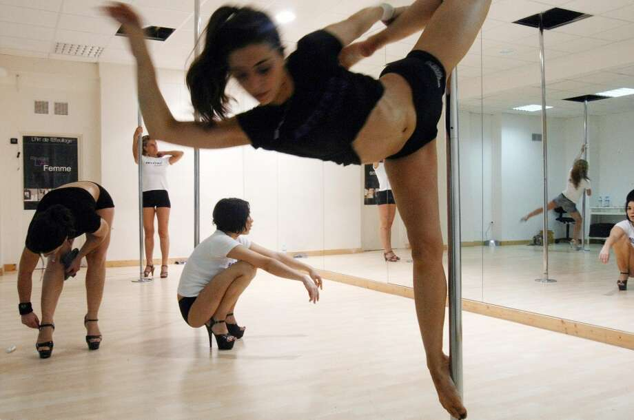Recent picture of female dancers practicing at a pole-dancing school on June 27, 2008 in Paris. Photo: JOEL SAGET, AFP/Getty Images
