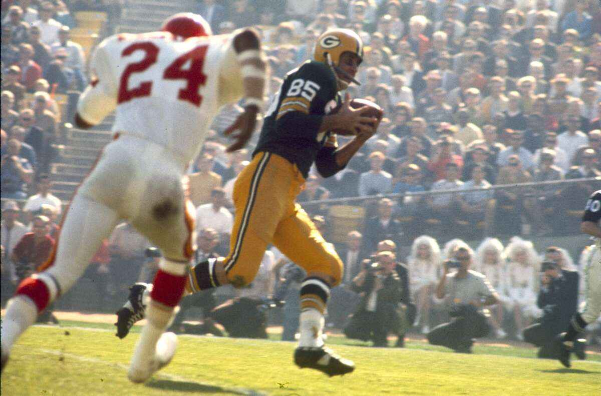20. McGee's super game: Max McGee stayed up late the night before Super Bowl I, missing Green Bay's curfew as he searched for late-night libations. But when Boyd Dowler was hurt early in the game, McGee was thrust into the Packers' lineup against Kansas City . Soon thereafter, he snagged a one-handed 37-yard TD grab over Wheatley-ex Willie Mitchell and finished as the game's MVP with seven receptions for 138 yards and two TDs