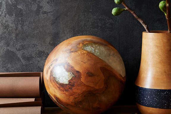 """A teak and resin sphere ($69) from West Elm; designer Barry Dixon likes the spheres because """"each one will be unique."""" MUST CREDIT: West Elm."""