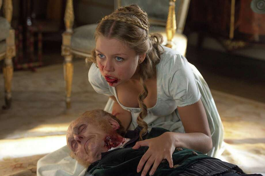 "This image released by Screen Gems shows Jess Radomska in a scene from ""Pride and Prejudice and Zombies."" (Jay Maidment/Screen Gems, Sony via AP) ORG XMIT: NYET122 Photo: Jay Maidment / Screen Gems/Sony"