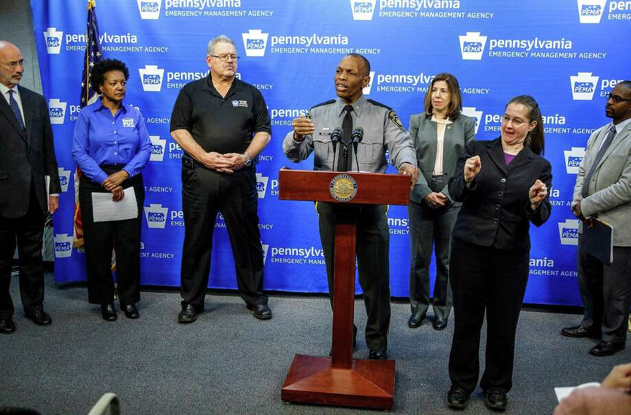 FILE - In this Jan. 21, 2016, file photo, Pennsylvania State Police Commissioner Col. Tyree Blocker, standing at the podium, discusses snowstorm preparations at the Pennsylvania Emergency Management Agency's headquarters in Susquehanna Township, Pa. In a statement issued Thursday, Feb. 4, 2016, Blocker said an investigation into possible cheating at the Pennsylvania State Police academy has involved dozens of interviews and extensive collection of evidence since the probe began in December. (Dan Gleiter/PennLive.com via AP, File) MANDATORY CREDIT ORG XMIT: PAHAP201 Photo: Dan Gleiter / PennLive.com