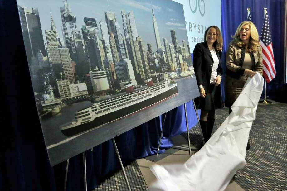 SS United States Conservancy Executive Director Susan Gibbs, left, and Crystal Cruises President & CEO Edie Rodriquez unveil an artist rendering of the SS United States,  in New York,  Thursday, Feb. 4, 2016. The conservation group and cruise line announced plans to overhaul the ocean liner, that once carried celebrities across the Atlantic at record speeds in its prime, but has been rotting on the Philadelphia waterfront for two decades. (AP Photo/Richard Drew) ORG XMIT: NYRD101 Photo: Richard Drew / AP