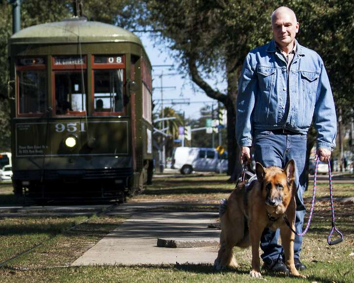 David Baldwin walks in crippled 13 year old German Shepherd, Sammy, along the streetcar tracks in New Orleans, LA, Thursday February 4, 2016. Baldwin, a former air traffic controller, is suing the Federal Aviation Administration for discrimination based on sexual orientation. There is no such anti-discrimination law in Florida, but the Obama administration has a asserted that a law against discrimination based on sexual orientation would be redundant under the 1964 civil rights act.