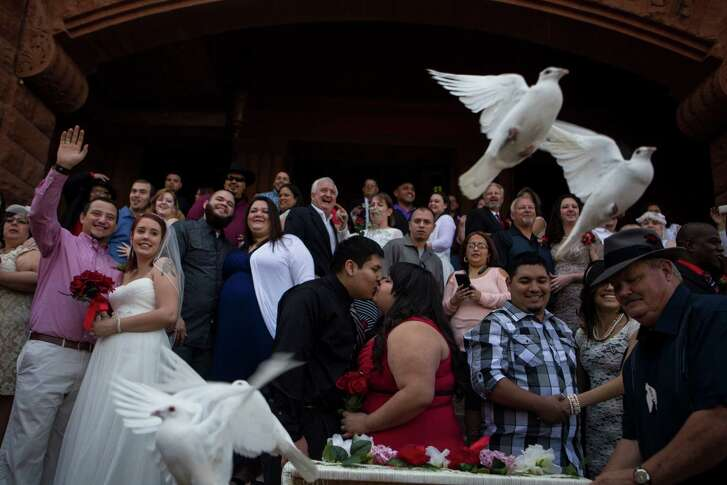 Doves are released after a free mass wedding on the steps of the Bexar County Courthouse on Valentine's Day 2014. County Clerk Gerry Rickhoff will conduct the ceremonies this year.