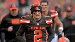 In this Dec. 6, 2015, file photo, Cleveland Browns quarterback Johnny Manziel walks off the field at halftime of a game against the Cincinnati Bengals in Cleveland. The Browns said in a statement, Tuesday, Feb. 2, 2016, that Manziel's troubles off the field have undermined his teammates and the organization.