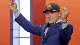 In this May 8, 2014, file photo, Texas A&M quarterback Johnny Manziel reacts after being selected by the Cleveland Browns as the 22nd pick during the first round of the NFL draft in New York. The Browns indicated Tuesday, Feb. 2, 2016, that theyve finally had enough of Manziels bad-boy behavior and intend to release the quarterback in March when the league begins its next calendar year.