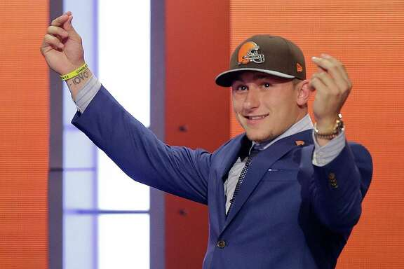 In this May 8, 2014, file photo, Texas A&M quarterback Johnny Manziel reacts after being selected by the Cleveland Browns as the 22nd pick during the first round of the NFL Draft in New York.