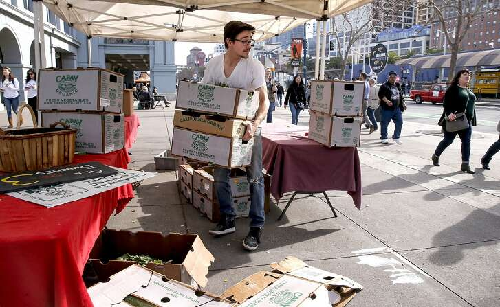 Steven Teilmann of Capay Organic carries boxes to his van as he closes up shop for the day at the Ferry Plaza Farmers Market in San Francisco, California, on Thursday February 4, 2016. Teilmann said that his business is down 25-40 percent since the street closures around Super Bowl City along the Embarcadero.