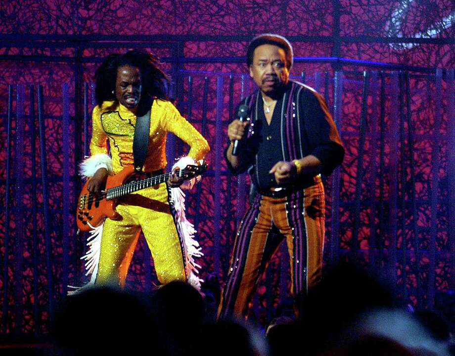 Guitarist Verdine White, left, and singer Maurice White of the group Earth, Wind and Fire perform during a tribute to funk at the 46th Annual Grammy Awards show in 2004. Maurice White died last week at age 74. Photo: Richard Hartog /McClatchy-Tribune News Service / Los Angeles Times