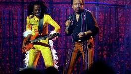 Guitarist Verdine White, left, and singer Maurice White of the group Earth, Wind and Fire perform during a tribute to funk at the 46th Annual Grammy Awards show in 2004. Maurice White died last week at age 74.
