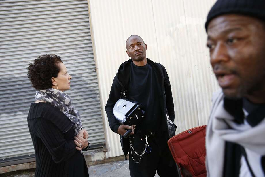 Potrero Hill resident Maria Cristini (left) talks with AramCinque Walker, who is homeless, on Division Street. Photo: Lea Suzuki, The Chronicle