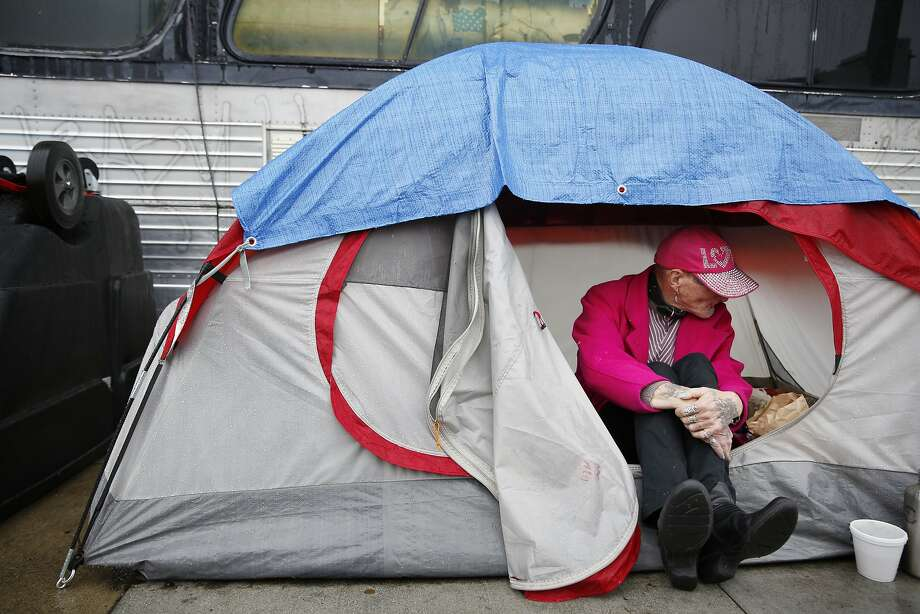 Kathy Gray, sits at the entrance to her tent along 13th Street  in the rain on Friday, January 22, 2016 in San Francisco, Calif. Photo: Lea Suzuki, The Chronicle