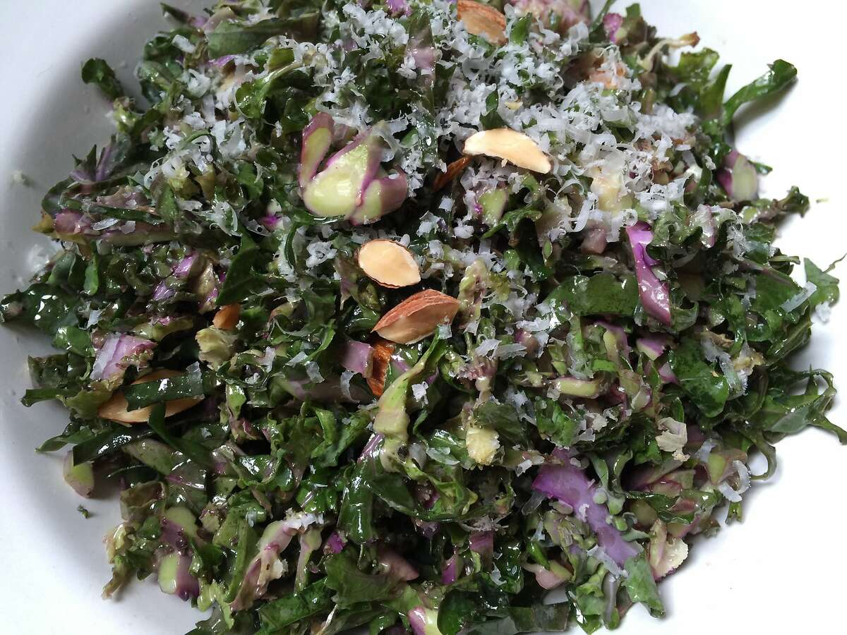 Kalettes are chopped fine for a raw, crisp salad