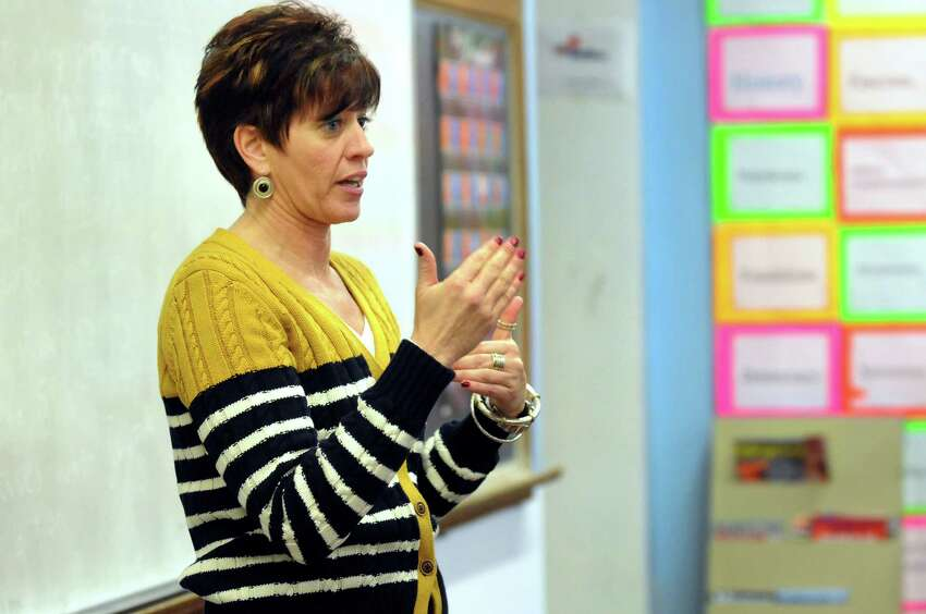 Watervliet Superintendent Lori Caplan informs the 12th-grade government class about the school's fiscal challenges on Thursday, Jan. 16, 2014, at Watervliet High in Watervliet, N.Y. Watervliet is the most fiscally stressed school in the entire state. (Cindy Schultz / Times Union)
