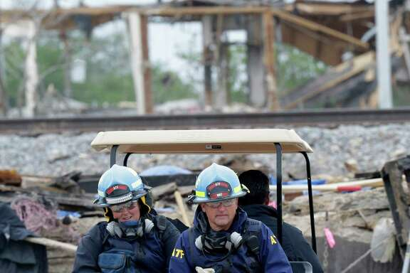 Investigators drive into the destroyed fertilizer plant in West, Texas, Thursday, May 2, 2013.  (AP Photo/LM Otero, Pool)