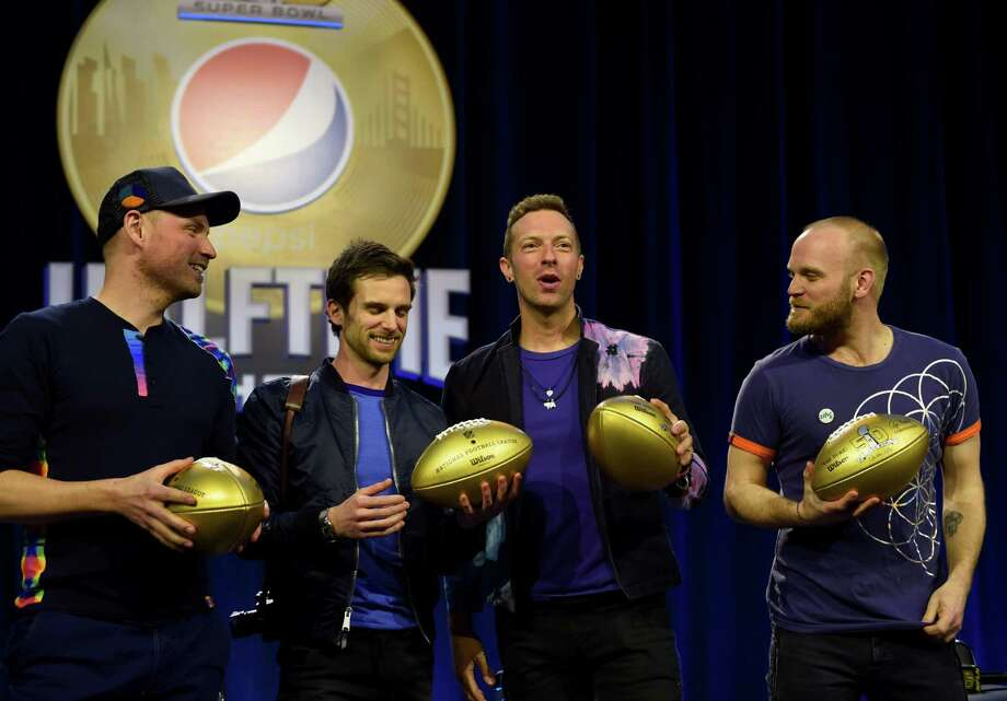 Musicians Jonny Buckland, Guy Berryman, Chris Martin and Will Champion Coldplay pose with footballs at the Pepsi Super Bowl Halftime Press Conference on February 4, 2016 at the Moscone Convention Center in San Francisco, California. / AFP / Timothy A. CLARYTIMOTHY A. CLARY/AFP/Getty Images Photo: TIMOTHY A. CLARY / AFP or licensors