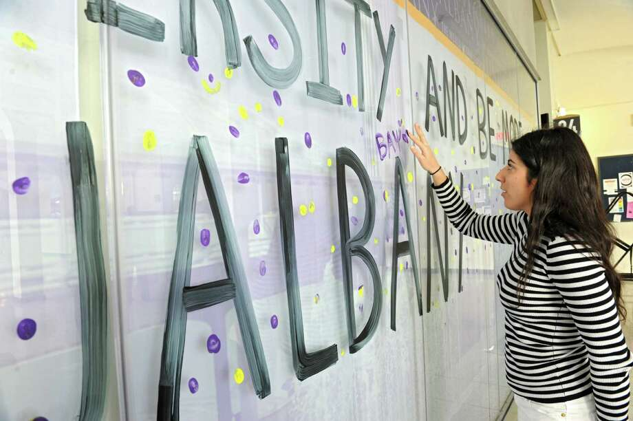 Senior UAlbany student Rachel Kukulier of Brooklyn puts her fingerprint , using paint, on a glass wall to pledge diversity and inclusion at University at Albany on Thursday, Feb. 4, 2016 in Albany, N.Y. (Lori Van Buren / Times Union) Photo: Lori Van Buren / 10035285A
