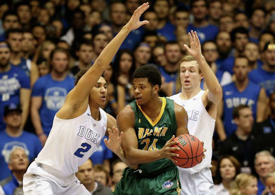 DURHAM, NC - NOVEMBER 13:  Lavon Long #24 of the Siena Saints tries to keep the ball from teammates Chase Jeter #2 and Luke Kennard #5 of the Duke Blue Devils during their game at Cameron Indoor Stadium on November 13, 2015 in Durham, North Carolina.  (Photo by Streeter Lecka/Getty Images) ORG XMIT: 587451721 Photo: Streeter Lecka / 2015 Getty Images