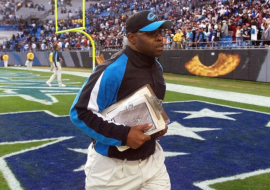 "FILE - In this Nov. 16, 2003, file photo, Carolina Panthers linebackers coach Sam Mills leaves the field after the Panthers' game against the Washington Redskins in Charlotte, N.C. The Panthers motto is everywhere, on stadium walls, plaques and even the team jerseys: ""Keep Pounding."" The advice comes from Mills, a Panthers linebacker who died of intestinal cancer and is honored with a statue outside the team's stadium.  (AP Photo/Rick Havner, File) ORG XMIT: NY175 Photo: Rick Havner / AP"