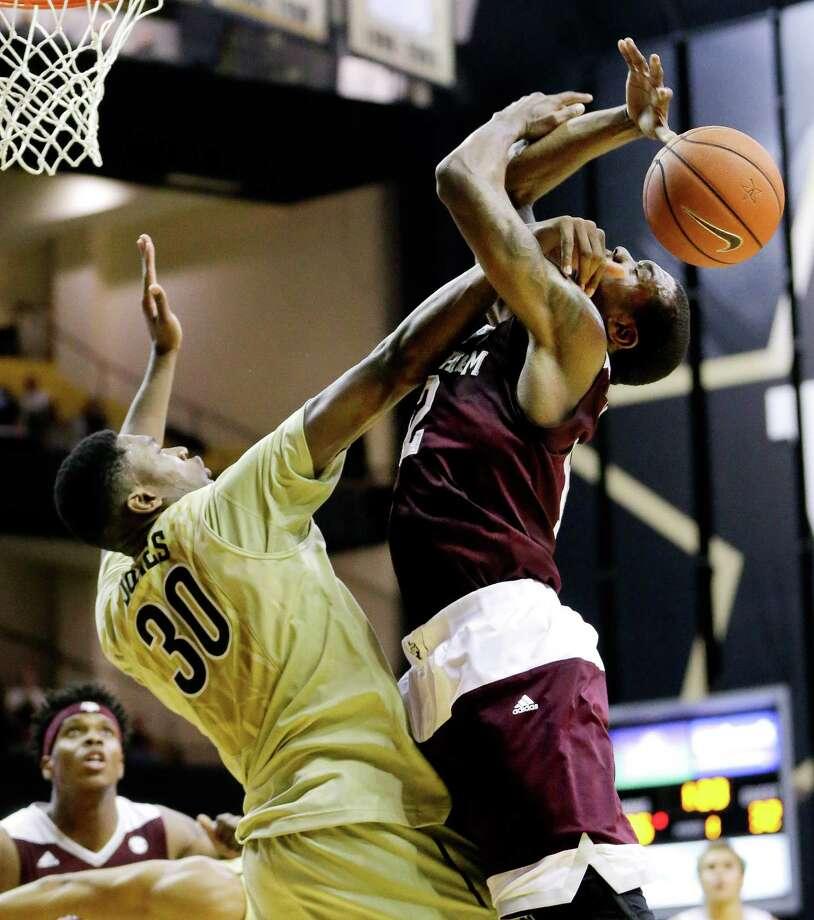Vanderbilt center Damian Jones (30) fouls Texas A&M guard Jalen Jones (12) in the first half of an NCAA college basketball game Thursday, Feb. 4, 2016, in Nashville, Tenn. (AP Photo/Mark Humphrey) ORG XMIT: TNMH102 Photo: Mark Humphrey / AP