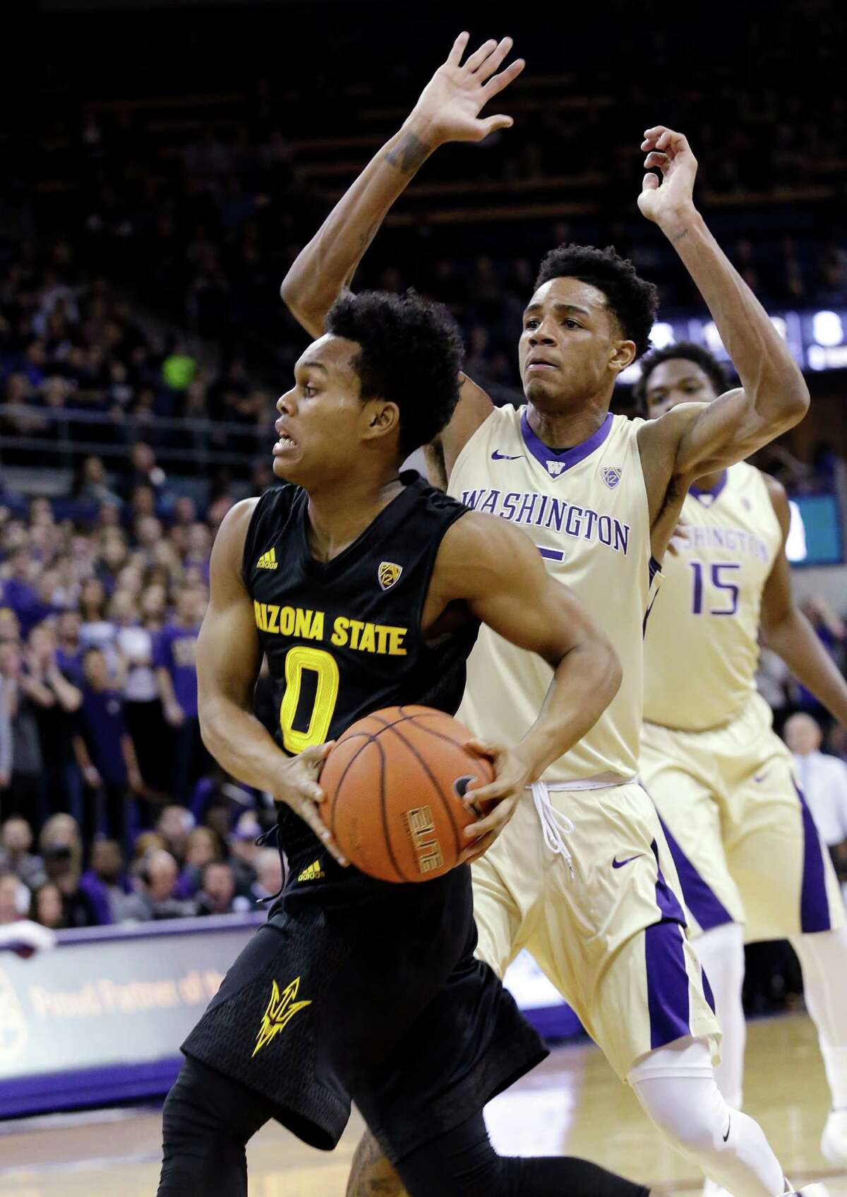Arizona State's Tra Holder (0) drives past Washington's Dejounte Murray during the first half of an NCAA college basketball game Wednesday, Feb. 3, 2016, in Seattle. (AP Photo/Elaine Thompson)