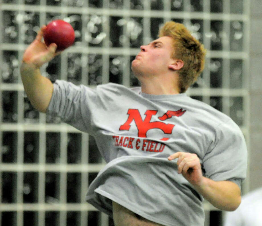New Canaan's Will Conley competes in the boys shot put event during the FCIAC Boys and Girls Track Championships at the Floyd Little Athletic Center in New Haven, Conn. on Feb. 4, 2016. Photo: Matthew Brown / Hearst Connecticut Media / Stamford Advocate