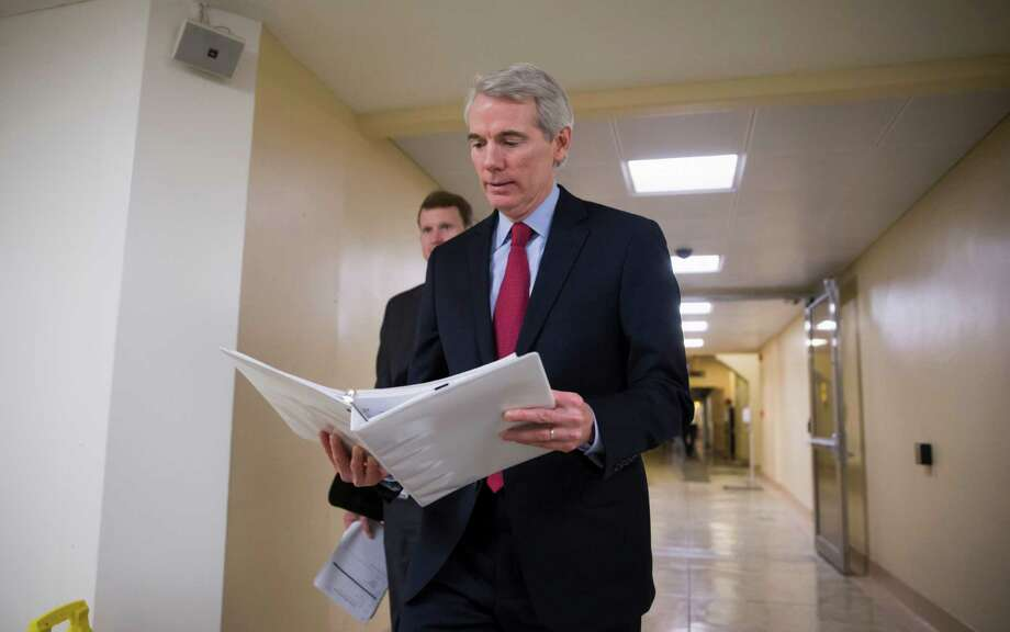 Sen. Rob Portman, R-Ohio leaves the Capitol in Washington, Thursday, Feb. 4, 2016, after progress on the bipartisan energy reform bill collapsed. Senate Democrats blocked the comprehensive energy bill after majority Republicans would not agree to send hundreds of millions of dollars in emergency federal aid to Flint, Michigan, to fix and replace the city's lead-contaminated pipes as part of the legislation.  (AP Photo/J. Scott Applewhite) ORG XMIT: DCSA108 Photo: J. Scott Applewhite / AP