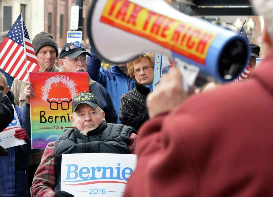 Bernie Sanders supporters, including Steve Chagnon, seated center, rally outside the State Board of Elections as they await the filing of petitions Thursday Feb. 4, 2016 in Albany, NY.  (John Carl D'Annibale / Times Union) Photo: John Carl D'Annibale / 10035264A