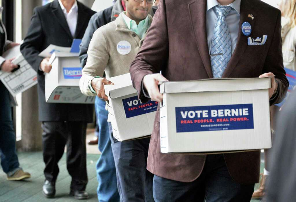 Bernie Sanders supporters carry boxes of petitions into  the State Board of Elections Thursday Feb. 4, 2016 in Albany, NY.  (John Carl D'Annibale / Times Union) Photo: John Carl D'Annibale / 10035264A