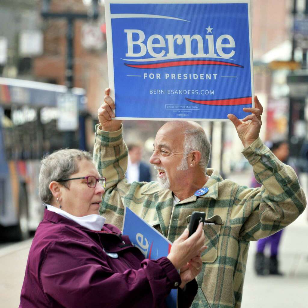 Robin Gray, left, of Albany, and Mike Jurkovic of Wallkill join Bernie Sanders supporters as they rally outside the State Board of Elections as they await the filing of petitions Thursday Feb. 4, 2016 in Albany, NY.  (John Carl D'Annibale / Times Union) Photo: John Carl D'Annibale / 10035264A