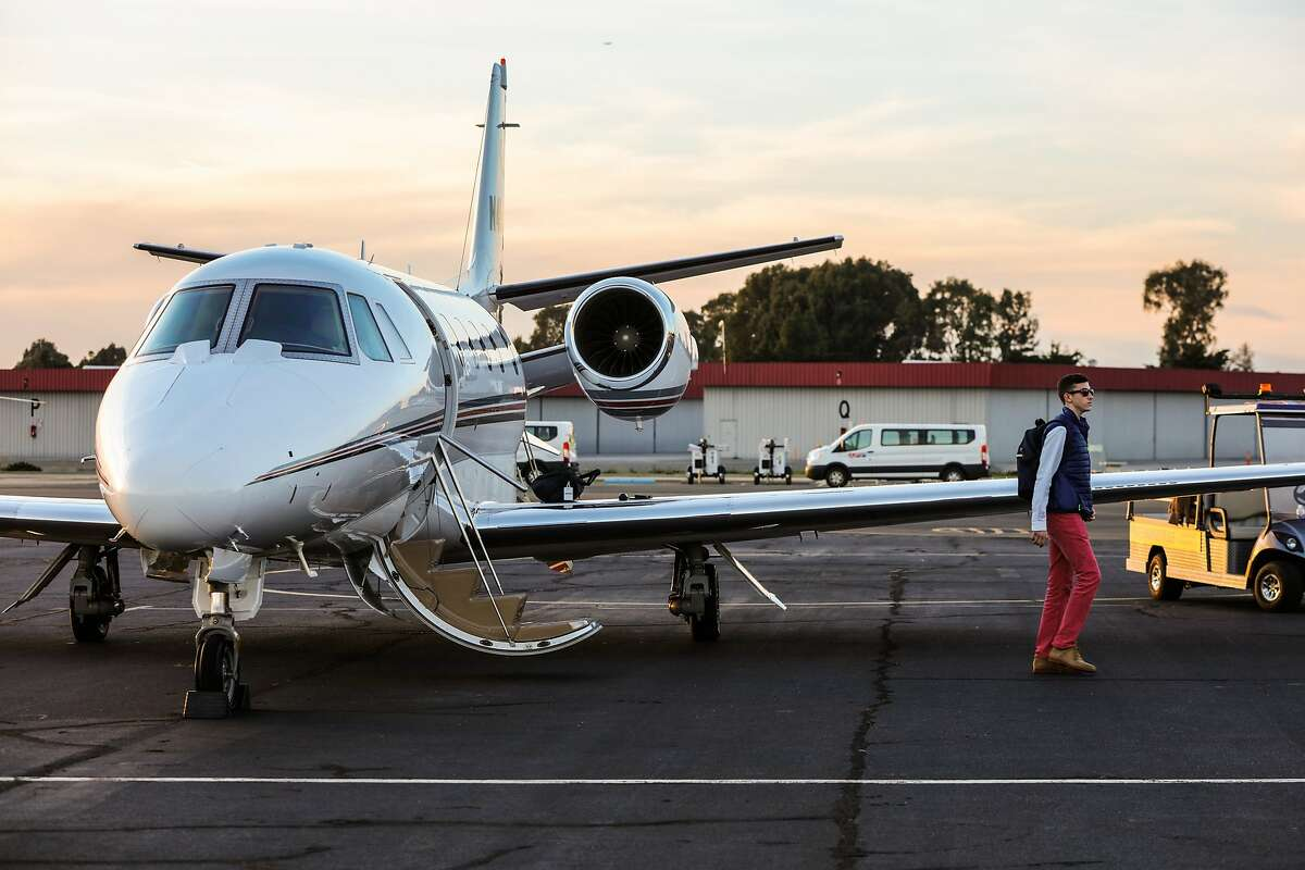 Seth Herndon, of North Carolina, walks off of his father's private plane, at the APP jet center in Hayward, California on Thursday, February 4, 2016. He is in town for the Super Bowl and looking forward to exploring the city.