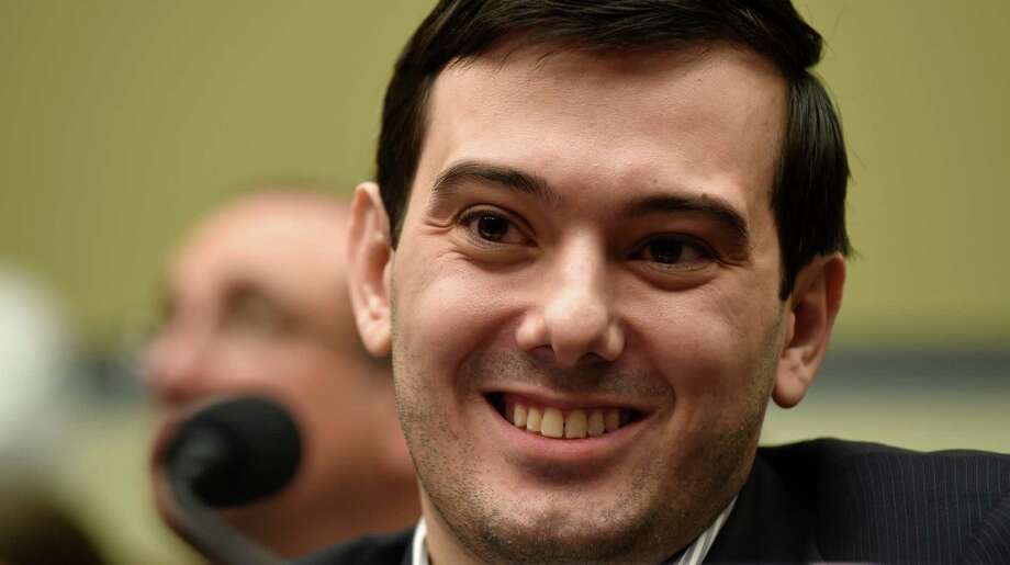 Pharmaceutical chief Martin Shkreli smiles on Capitol Hill in Washington, Thursday, Feb. 4, 2016, during the House Committee on Oversight and Reform Committee hearing on his former company's decision to raise the price of a lifesaving medicine. Shkreli refused to testify before U.S. lawmakers who excoriated him over severe hikes for a drug sold by a company that he acquired. (AP Photo/Susan Walsh) ORG XMIT: DCSW121 Photo: Susan Walsh / AP