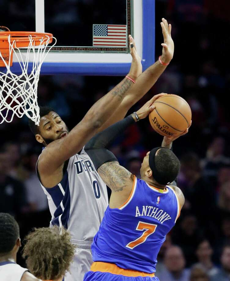 New York Knicks forward Carmelo Anthony (7) shoots over the defense of Detroit Pistons center Andre Drummond (0) during the first half of an NBA basketball game, Thursday, Feb. 4, 2016 in Auburn Hills, Mich. (AP Photo/Carlos Osorio)   ORG XMIT: MICO106 Photo: Carlos Osorio / AP