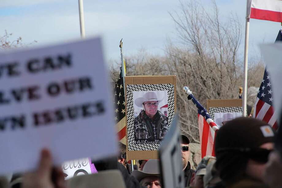 A sign is displayed with the picture of LaVoy Finicum as part of the demonstrations outside the Harney County Courthouse in Burns, Ore., Monday, Feb. 1, 2016. Hundreds gathered to protest and support the armed occupation of a national wildlife preserve. (Molly Young/The Oregonian via AP) MAGS OUT; TV OUT; NO LOCAL INTERNET; THE MERCURY OUT; WILLAMETTE WEEK OUT; PAMPLIN MEDIA GROUP OUT; MANDATORY CREDIT  ORG XMIT: ORPOR203 Photo: Molly Young / The Oregonian