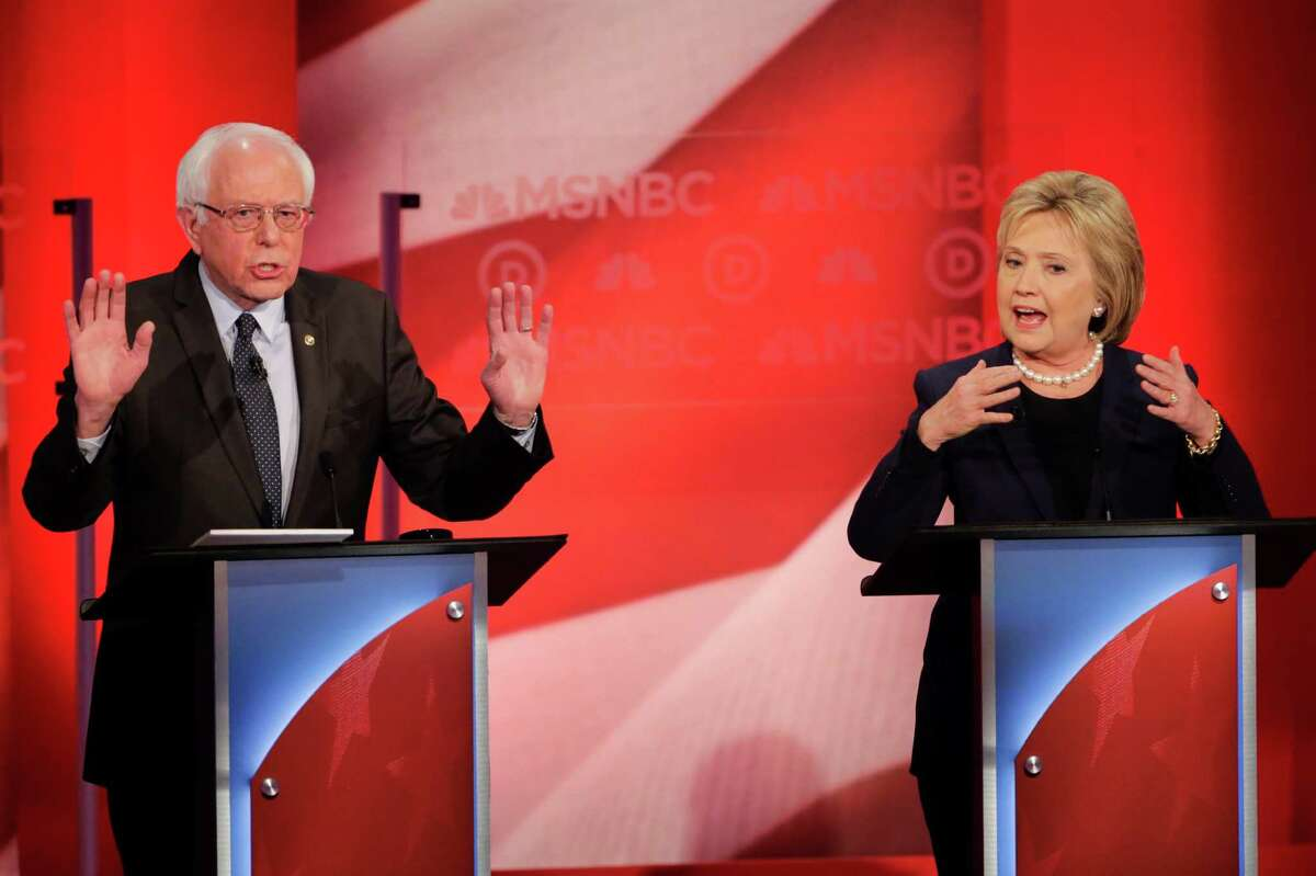 Democratic presidential candidate, Sen. Bernie Sanders, I-Vt, and Democratic presidential candidate, Hillary Clinton spar during a Democratic presidential primary debate hosted by MSNBC at the University of New Hampshire Thursday, Feb. 4, 2016, in Durham, N.H.