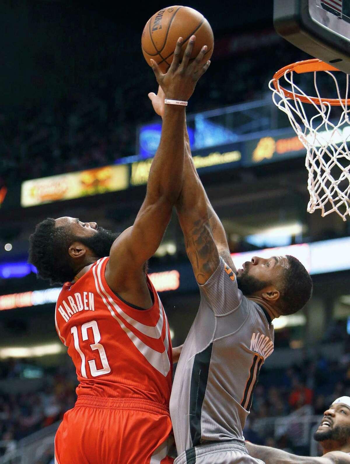 Houston Rockets guard James Harden (13) draws the foul on Phoenix Suns forward Markieff Morris during the second quarter of an NBA basketball game Thursday, Feb. 4, 2016, in Phoenix. (AP Photo/Rick Scuteri)