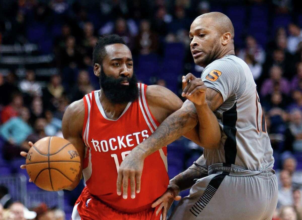 Houston Rockets guard James Harden, left, drives on Phoenix Suns forward P.J. Tucker in the first quarter of an NBA basketball game Thursday, Feb. 4, 2016, in Phoenix. (AP Photo/Rick Scuteri)