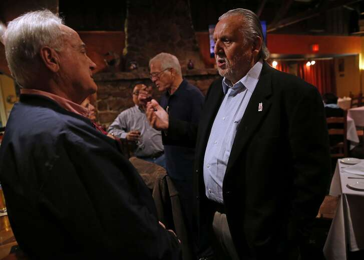 Photographers Mickey Palmer (right) and John Biever chat before they are celebrated at a dinner honoring their 50th Super Bowl as photographers in Half Moon Bay, Calif., on Thursday, February 4, 2016.