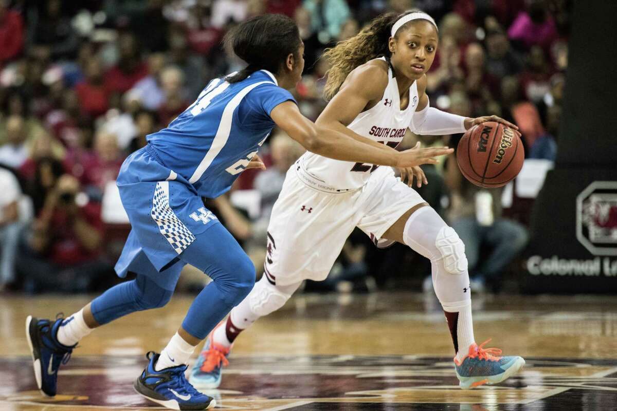 South Carolina guard Tiffany Mitchell, right, dribbles around Kentucky guard Taylor Murray, left, during the first half of an NCAA college basketball game Thursday, Feb. 5, 2016, in Columbia, S.C. South Carolina defeated Kentucky 78-68. (AP Photo/Sean Rayford)