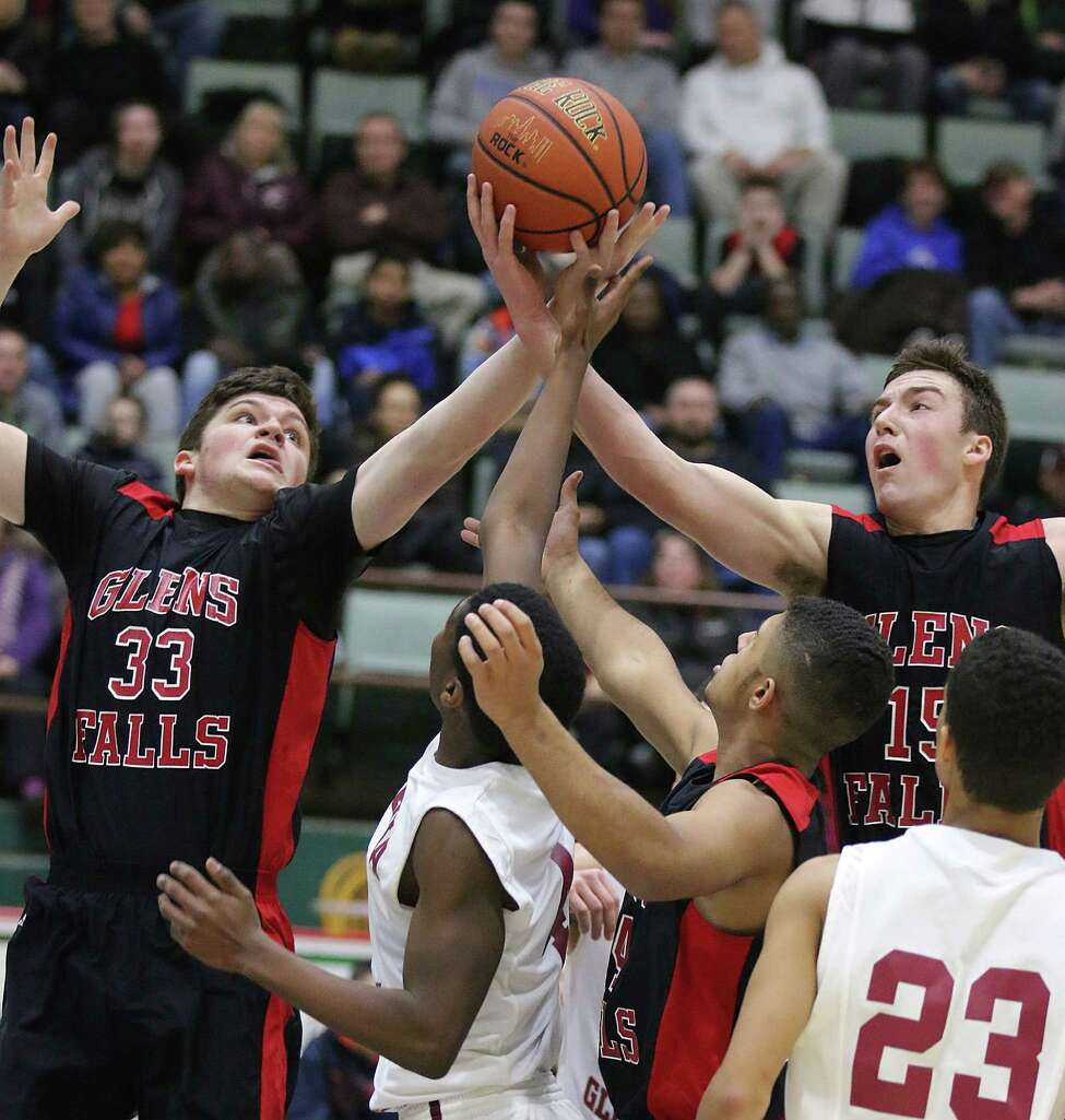 Glens Falls' Connor Schliff (33) and Andrew Stamatel vie for a rebound against Scotia-Glenville's Christian Corker during the Foothills Council boys varsity basketball championship at the Glens Falls Civic Center Thursday February 4, 2016. (Ed Burke/Special to The Times Union)