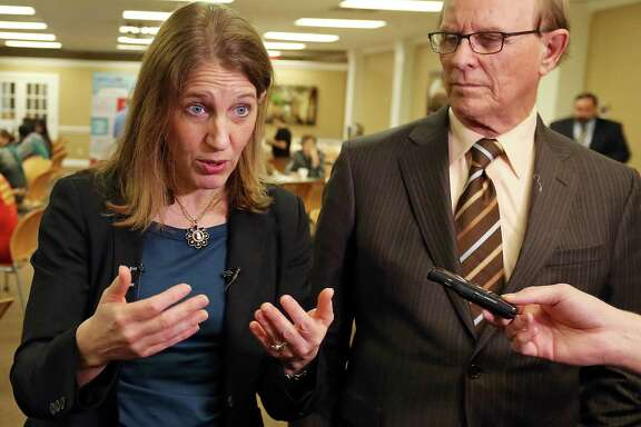 U.S. Department of Health and Human Services Secretary Sylvia M. Burwell (left) answers questions from the media after she and Bexar County Judge Nelson Wolff toured a health insurance enrollment event Friday Jan. 29, 2016 at Southwest General Hospital.