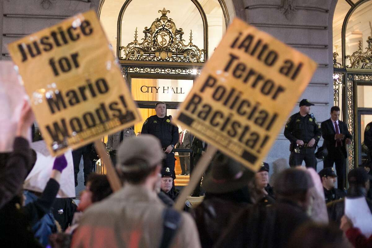 Dozens of activists protest outside City Hall on Feb. 4, 2016, in San Francisco.