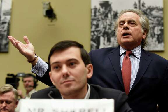 Benjamin Brafman, right,  attorney for pharmaceutical chief  Martin Shkreli, foreground, seeks to speak for his client Thursday in Washington. Shkreli invoked his Fifth Amendment right.
