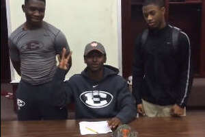 High school football player signs with 'Whataburger University' - Photo