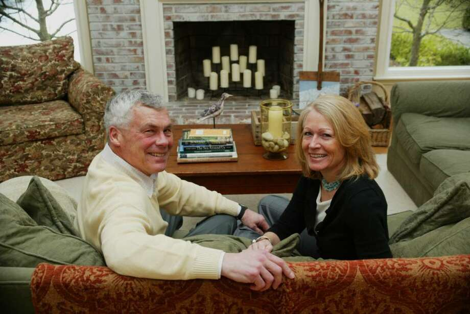 Oz Griebel and his wife Kirsten relax in front of the fireplace in their home in Simsbury on Thursday, March 11, 2010. Griebel is a candidate for the GOP nomination for governor of Conn. Photo: Phil Noel / Connecticut Post