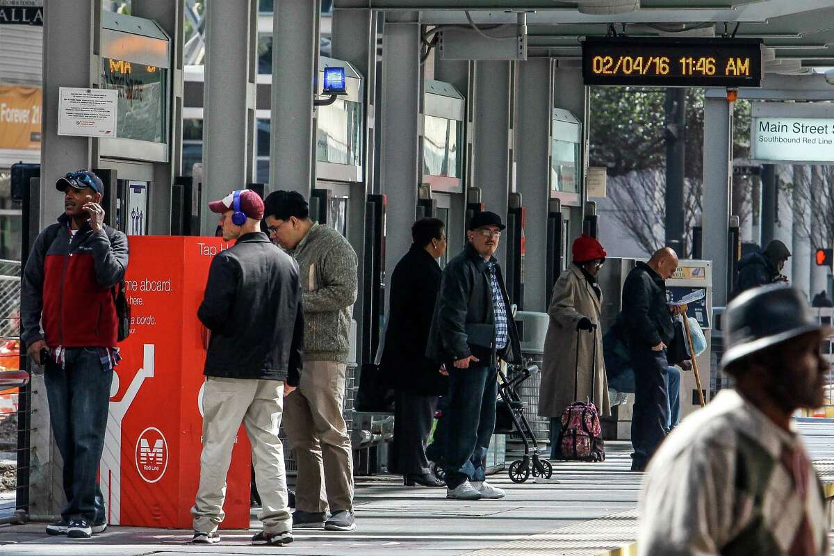 A man buys a Metro rail ticket at the Main Street Square Station as he waits for the train on Feb. 4. Metro has developed a new app that allows riders to buy tickets on their phones instead of using the machine at the stations, which will debut next week.