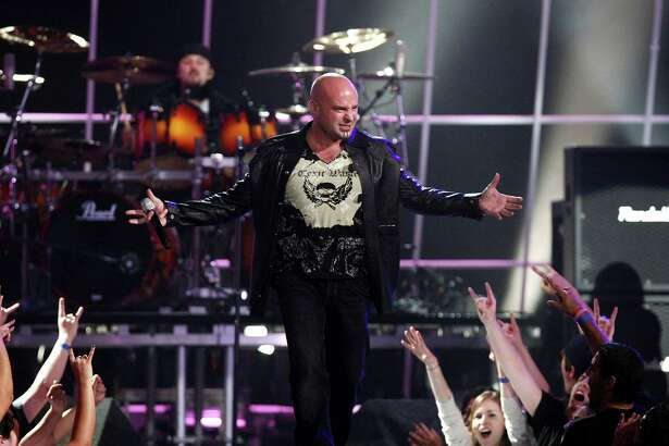 """Singer David Draiman performs with band Disturbed onstage during the taping of Spike TV's 2nd Annual """"Guys Choice"""" Awards held at Sony Studios on May 30, 2008 in Culver City, California. The show airs on June 22, 2008 at 10PM ET/PT on Spike TV. (Photo by Alberto E. Rodriguez/Getty Images)"""