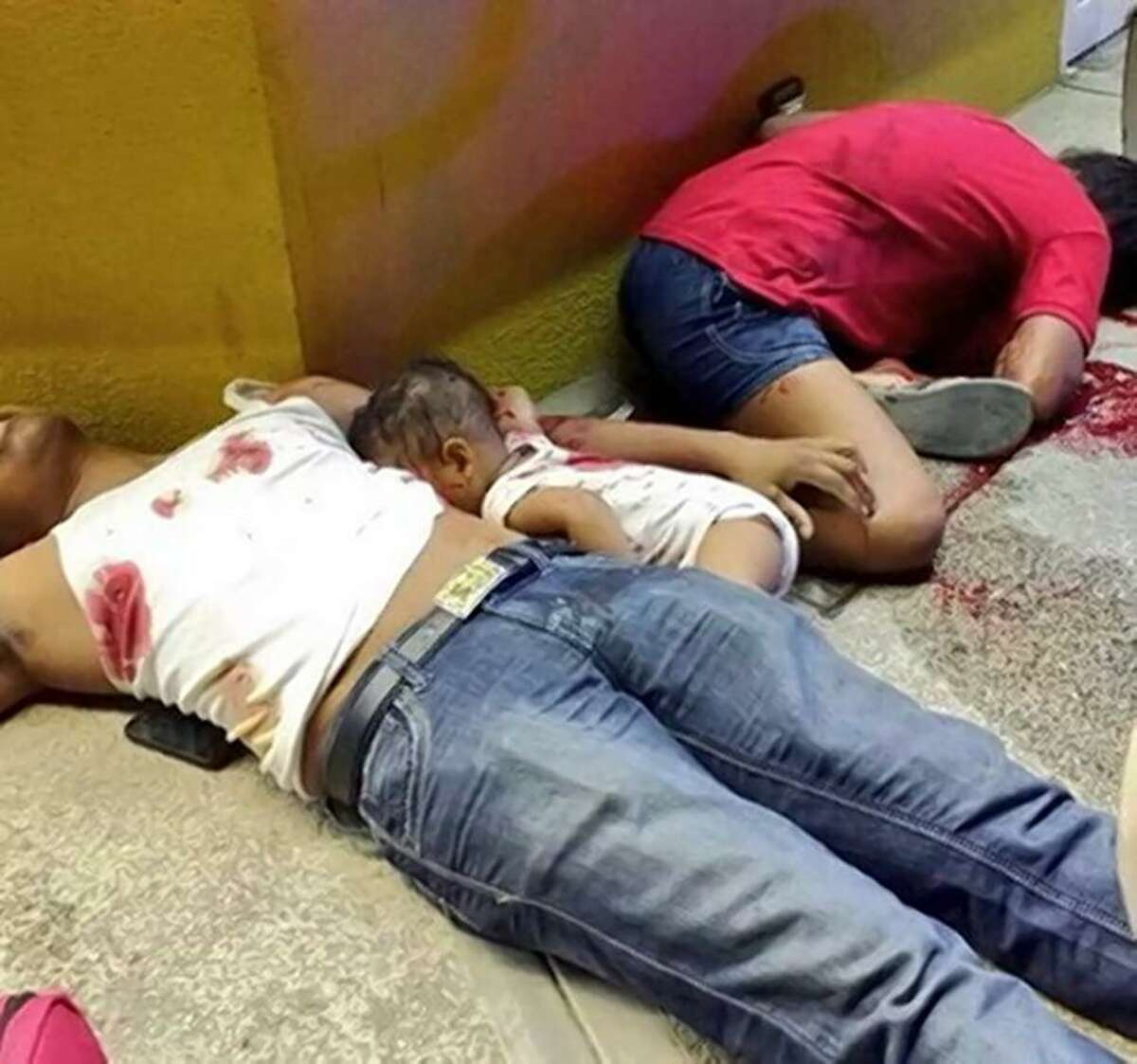Marcos Miguel Pano Colón was in the arms of his 24-year-old father Juan Alberto Pano Ramos when they were shot and killed on Friday outside of a convenience store in Pinotepa Nacional in Oaxaca state. The photo has sparked a wave of anger over the country's gang violence.